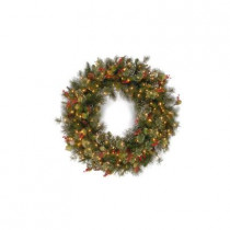 30 in. Wintry Pine Artificial Wreath with Pine Cones, Red Berries, Snow and 100 Clear Lights